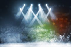 Tile floor with concert spot lighting and smoke. With defocused colorful lights background royalty free stock photo