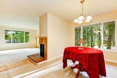 Tile floor dining room interior with elegant red table cloth. Stock Photo