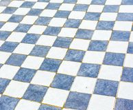 Floor slabs. Is a tile floor that looks like a chess board stock photography