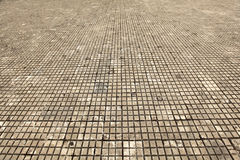 Tile floor made of stone, dirty white and old Royalty Free Stock Image