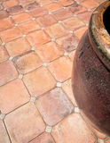 Tile floor and pottery Stock Images