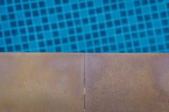 Tile floor with swimming pool Stock Photography