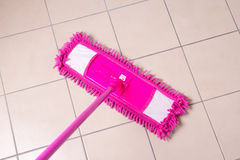 Tile floor washing with a mop Stock Photography