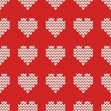 Tile knitting vector pattern with white hearts on red background Royalty Free Stock Photo