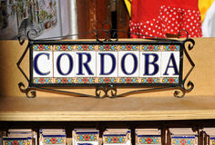 Tile label, Craft souvenirs in Cordoba, Spain. Handicrafts store for tourists near the Mosque of Cordoba, Andalusia, Spain royalty free stock photos