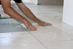 Tile laying tiles Royalty Free Stock Photography