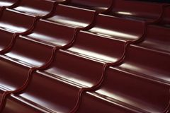 Tile of metal. Sheet of rolled metal. Close up. Technology background Stock Photos