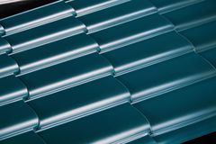 Tile of metal. Sheet of rolled metal. Close up. Technology background Royalty Free Stock Photo