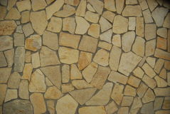 Tile mosaic. Light brown rocks or stone tile arranged in a mosaic pattern Royalty Free Stock Photos