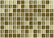 Tile mosaic square decorated with glitter golden texture background Stock Photos