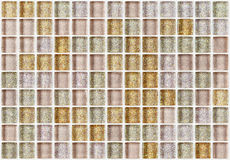 Tile mosaic square decorated with glitter golden texture background Stock Image