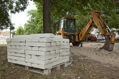 Tile paths construction with loader Royalty Free Stock Photos