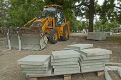 Tile paths construction with loader Stock Photo