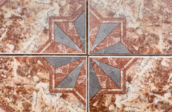 Tile pattern of ancient ceramic tiles. Stock Photos