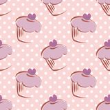 Tile vector pattern with cupcake and polka dots ba. Seamless lavender vector pattern or tile background with white polka dots and big hand drawn cupcakes Royalty Free Stock Photos