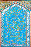 Tile patterns on a beautiful blue color wall of historical persian house in Isfahan, Iran. Stock Photography