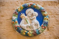 Tile representing a religious scene on the street Royalty Free Stock Image