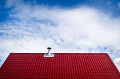 Tile roof. Different looking tin chimney on tile roof Stock Image