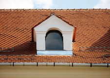 Tile roof. Window with tile roof and snow safety bars Stock Images