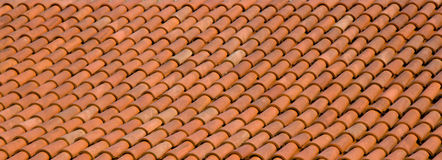 Tile roof. A terracotta orange tiled roof Royalty Free Stock Photos