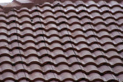Tile Roof. Red clay roofing tiles Stock Photo
