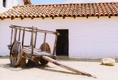 Tile roof adobe building with old cart (film)Book Cover. Adobe building with tile roof & old cart Santa Barbara, CA Stock Image