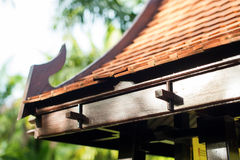 Tile Roof of Asian Arbour in a Garden Buddhism. Tile Roof of Asian Arbour House in a Garden Buddhism Building Summer Background Royalty Free Stock Photos
