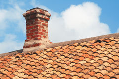 Tile roof with brick chimney Stock Photos