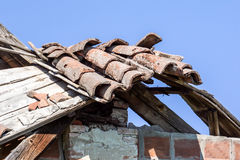 Tile Roof damaged and needing repair Stock Photos