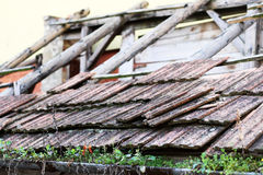 Tile Roof. Damaged by time and needing repair Royalty Free Stock Photo
