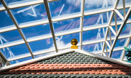Tile Roof with Glass Atrium Roof in Background Stock Image