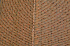 Tile roof of the house. Tile roof as a background Stock Photos