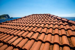 Tile roof on the old house Royalty Free Stock Photo