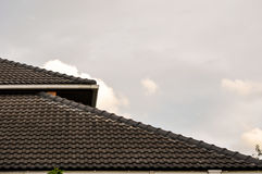 Tile roof pattern on sky cloudy background Stock Photo