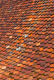 Tile roof sloped. Pitched roof at an angle, an old house Stock Images