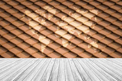 Tile roof texture surface with Wood terrace and world map Stock Photo