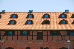 Tile Roof With Windows Of An Old Brick House Royalty Free Stock Photos