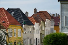 Tile roofs of Bergen, Norway and green street lamps Stock Photo