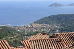 Tile roofs and Marciana Marina view Royalty Free Stock Images