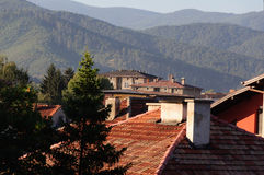 Tile roofs. Old area of Velingrad, Bulgaria. View to Rhodopes Stock Photos