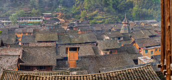 Tile roofs of wooden houses in large ancient chinese village. Royalty Free Stock Photos