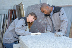 Tile setters inspecting delivery Royalty Free Stock Images