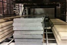 Stacked tiles Tile on Warehouse Shelf. Tile in stacks on DIY warehouse shelf Royalty Free Stock Image
