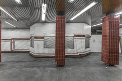 Tile in a subway station with a closed booth. With dramatic lighting Royalty Free Stock Image
