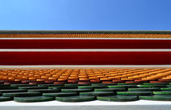 Tile temple roof with blue sky background, in Bangkok, Thailand Stock Image