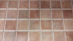 Tile texture with tiny squares and shades of brown. Tile model in a construction store. Shot taken with smartphone, close-up Stock Image