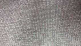 Tile texture with tiny squares and shades of grey. Tile model in a construction store. Shot taken with smartphone, close-up Stock Photo