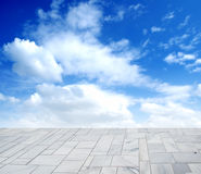 Tile textured ground and the sky Royalty Free Stock Photography