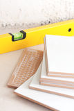 Tile and tool level Royalty Free Stock Images