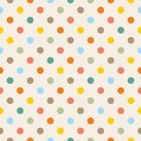 Tile vector pattern with colorful polka dots on pastel background Royalty Free Stock Image